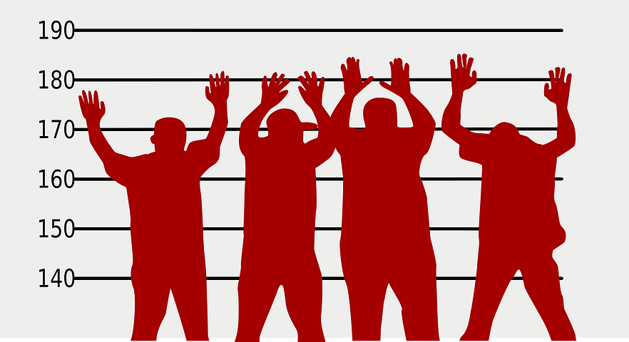 crime suspects with their hands up in the air